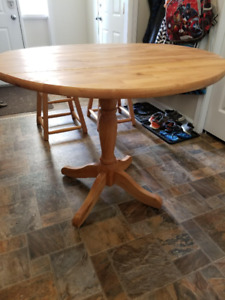 Wooden expanding table and stools