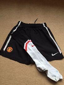 Man Utd football shorts and socks age 10-12