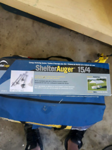 Portable shelter with augur set