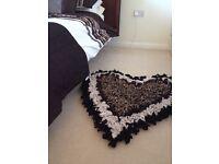 Heart shaped rag rug.