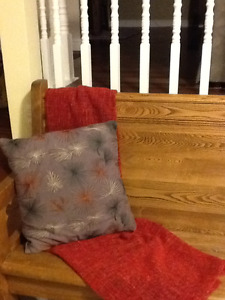 Red Ikea throw & Brown cushion