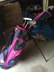 Girls golf clubs and standing bag