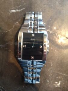 Selling Men's silver Guess watch