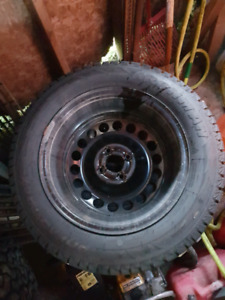 Almost new 185/65/15 winters and steelies