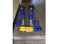 Front & back adjustable coil overs