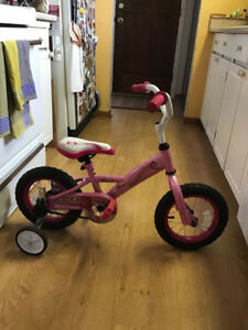 Felix andWilliam 12in girls bike with training wheels, excellent