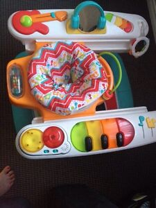 Toys r us  piano exersaucer