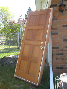 used solid cedar door, framed and with locks $85.00