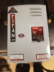 Titan on demand water heater model #160 volts 240VAC 66 amps