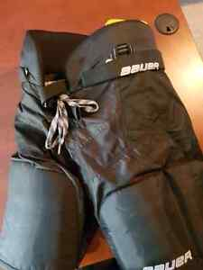 Hockey pants . Upper body and elbow pads