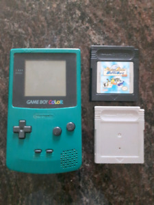Gameboy colour with Pokemon silver and monster rancher