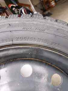 set of 4 winter tires on rims size 205/50R16