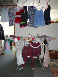 10 dresses, 2 tops, pjs, 5 hats, clothes for dolls, 23 hangers