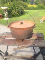 """VINTAGE 12"""" FOOTED CAST IRON DUTCH OVEN USA."""