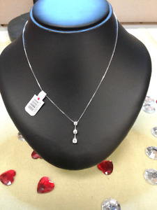 White gold 14k necklace and white gold 14k three diamond pendent