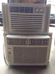 Two in-window air conditioners