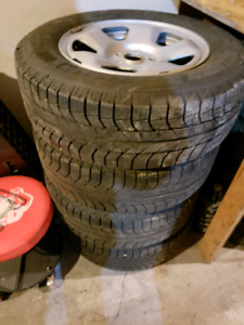 245 65 R17 Michelin X Ice Winter Tires with rims