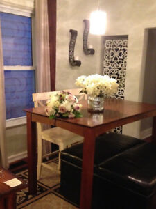 Bar height table and four solid wood bar height chairs