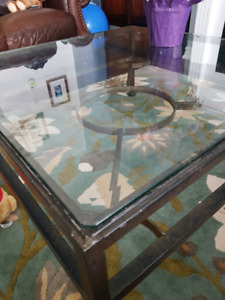 Wrought iron and glass top coffee table