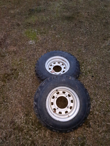 4 wheeler rims and used tires.  Set of 4