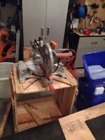 12 inch compound miter saw and folding  rigid stand in box.