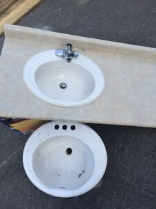 Sink, counter top and tap.