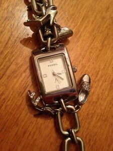 Beautiful fossil charm watch. Never worn.