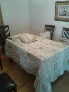 Used table to display single bed covers & drapes. Crib blanket.