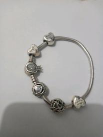 Pandora bracelet with charms