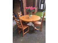 Large farmhouse table with four chairs