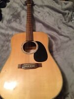Takamine g series acoustic guitar.
