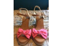 Sandal heels with a pink bow