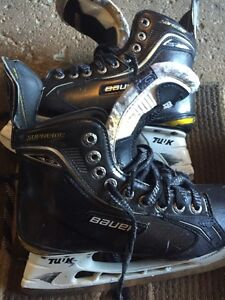 2 pairs of youth EE Bauer One 100 skates