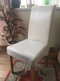 Four leather look high back chairs