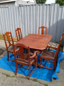 Six cherry wood chairs and table