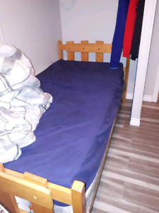 Single bed and table and chairs