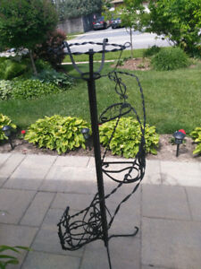 Antique rought iron garden plant stand