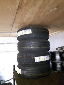4 pneus été 215/65R15 Michelin defender neufs,