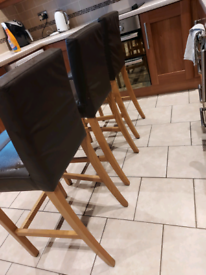 3 high brown leather chairs