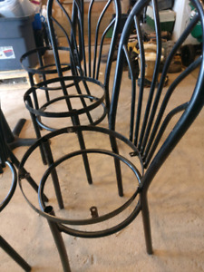 Restaurant metal chair frames (8) and table legs (3) $50