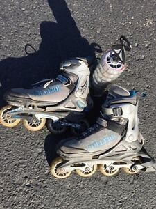 Rollerblades. Size 5-8 adjustable, with new set of wheels