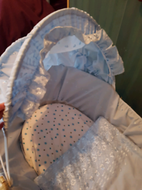 Moses basket with accessories.
