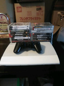 Ps3 with all cords and 21 games