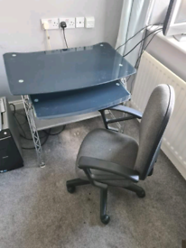 Glass computer desk with swivel chair