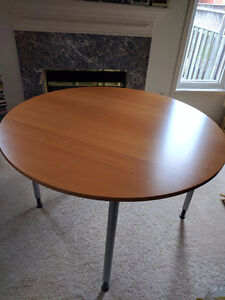 Circular wood dining room table for sale