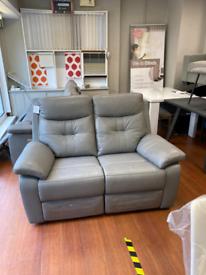 5. Brand new reclining Italian leather grey sofa