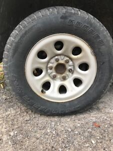 Winter tires on steel rims for GM pickup.