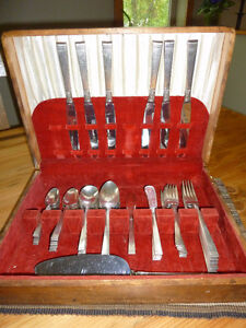 Stainless cutlery set with antique wooden case