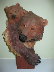 Grizzly mother bear and her cub bust on a wood base…