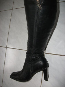 black leather boots by Browns